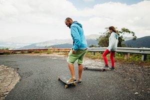 longboarding man and woman