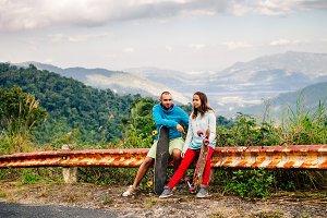 longboarding couple in tropics