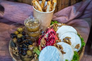 Camembert with nuts and olives
