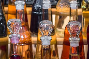 glass bottles filled with wine