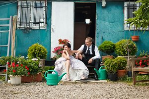 Tired wedding couple on the footstep
