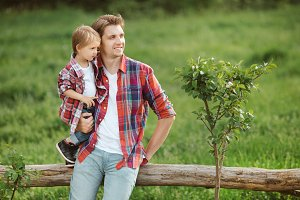 Cute little child outdoor with dad