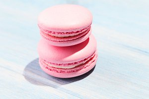 Two pink macarons