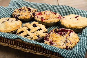 Homemade fruit pies in basket