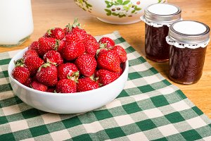 Bowl of red strawberries and jam