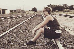Teen On Railroad Tracks