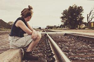 Girl Running down Railroad Tracks