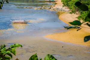 Banca Boats in Low Tide on Corong Corong Sandy Beach. Landscape of El Nido. Palawan Island. Philippines