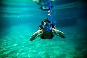woman snorkel underwater