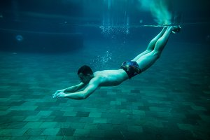 man swim underwater