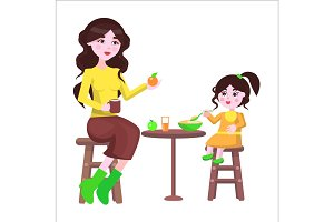 Mother and her Daughter Sit at the Table and Eat