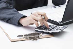 hands with the calculator on the desk, finance and business concept