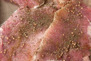 Pork meat on a baking pan