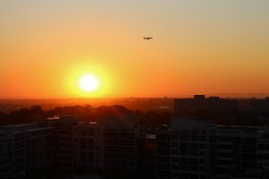 Plane during sunset over city