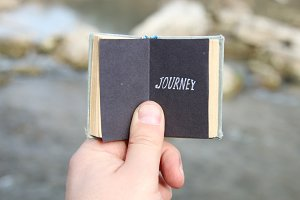Journey, The traveler holds a book with text