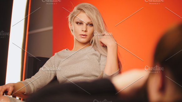 Blondy handsome girl posing for photographer - fashion backstage