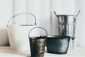 Empty pails on white background