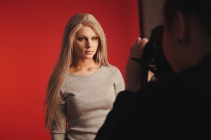 Blondy girl posing for photographer - fashion backstage