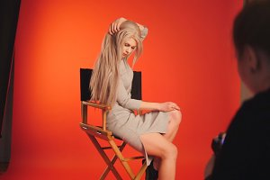 Blondy female posing for photographer - fashion backstage