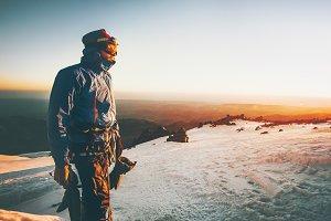 Man alpinist greet the dawn