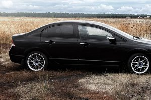 Panorama of black car in the field