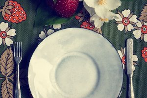 plate on a strawberry tablecloth