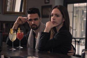 two people pub, woman looking away