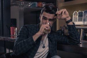 one young man drinking bar pub