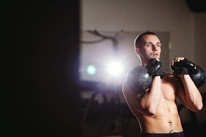 fitness man kettlebells workout