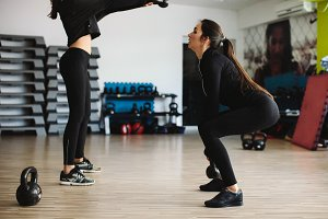 women kettlebell workout in gym