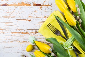 Easter table setting with fluffy willow and tulips