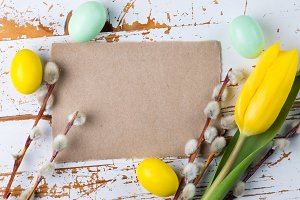 Easter card - decorations on rustic wood background