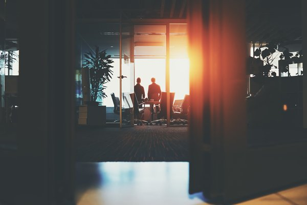 Silhouettes of two businessmen