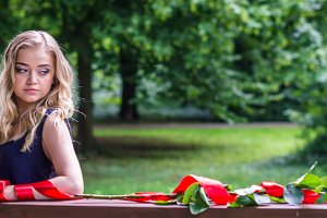 beautiful girl with rose and red tape