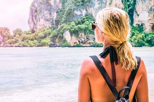 Blond beautiful Women with Sunglasses and Backpack on Raily, Hat Tom Sai Beach, Railay, Krabi
