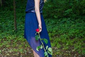 beautiful girl drags rose