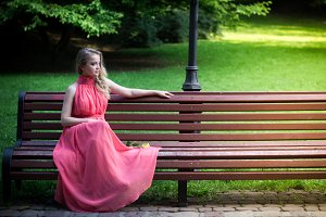 girl sits on park bench