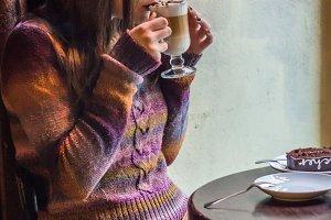 beautiful girl drinks coffee