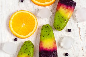 Colorful natural fruit ice cream on a stick. Top view