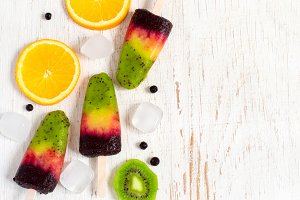 Colorful homemade ice cream on a stick made from natural fruit.