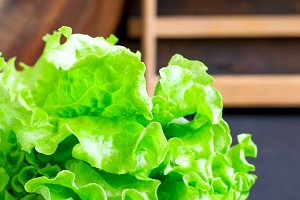 Lettuce leaves in a wooden bowl closeup
