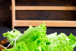 Lettuce on a wooden cutting board, copy space