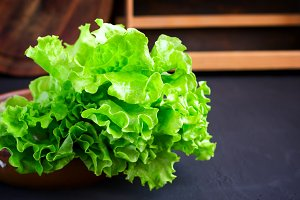 Fresh Lettuce in a wooden bowl closeup