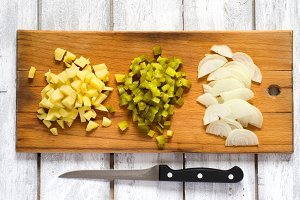Preparation rustic salad,  ingredients are cut into cubes, top v