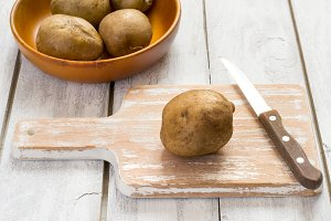 Boiled potato on a cutting board