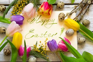 Easter greeting card with handwritten font, spring flowers and e