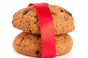 Oatmeal cookies with chocolate tied with red ribbon isolated on white background