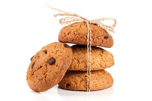 Oatmeal cookies with chocolate tied rope isolated on white background