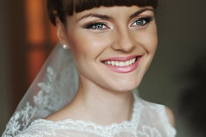 A portrait of a smiling bride