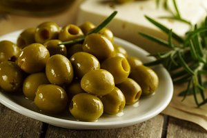 Tasty fresh green olives in bowl